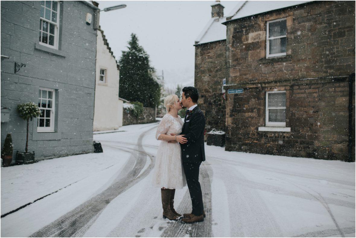 snowy winter weddding in falkland scotland