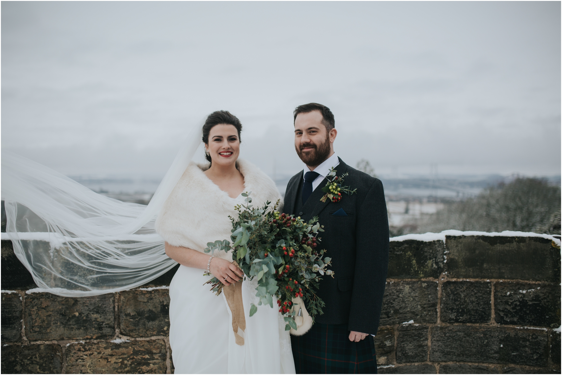 bride and groom in the snow at dundas castle