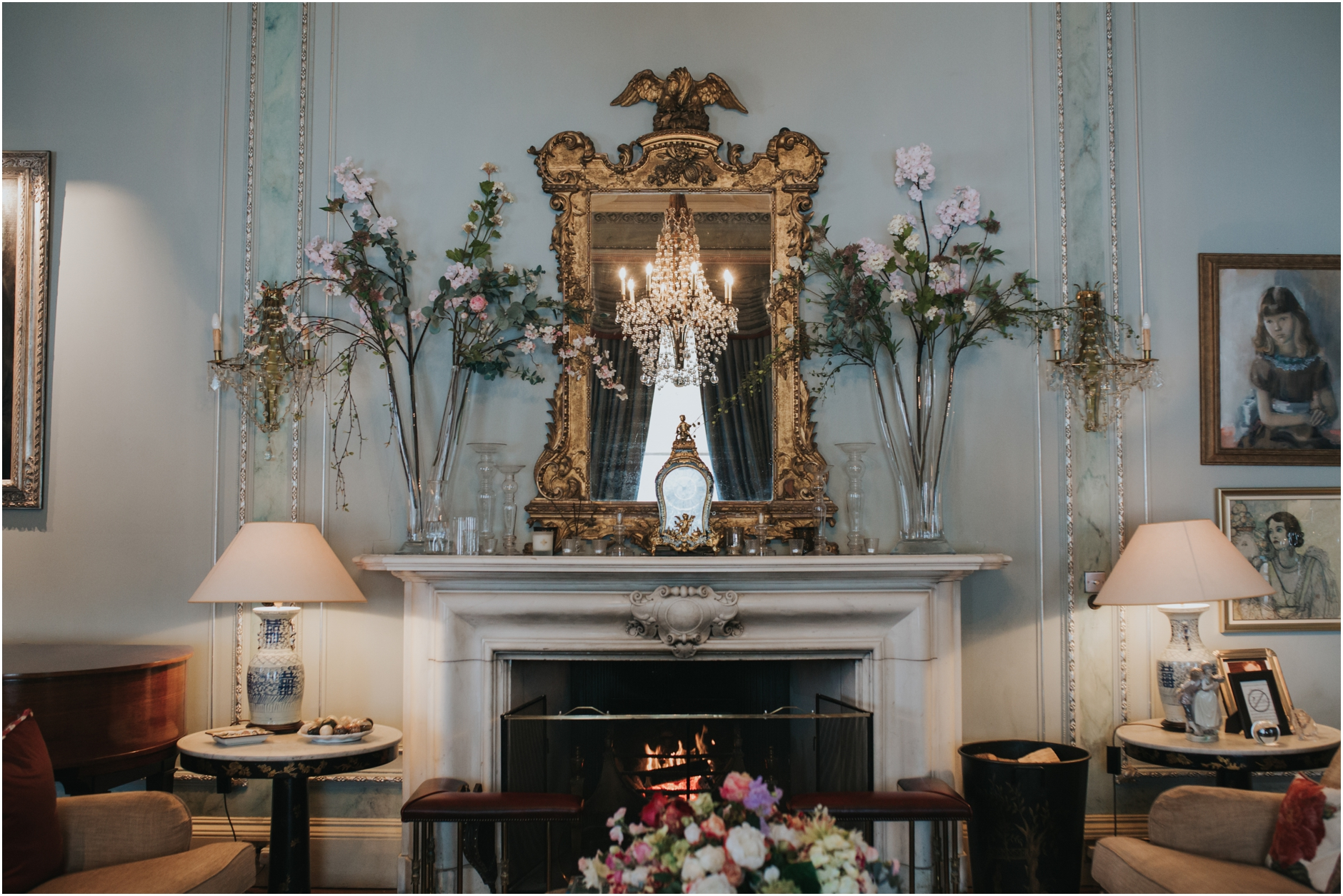 dundas castle drawing room with blue walls and gold mirror above fireplace
