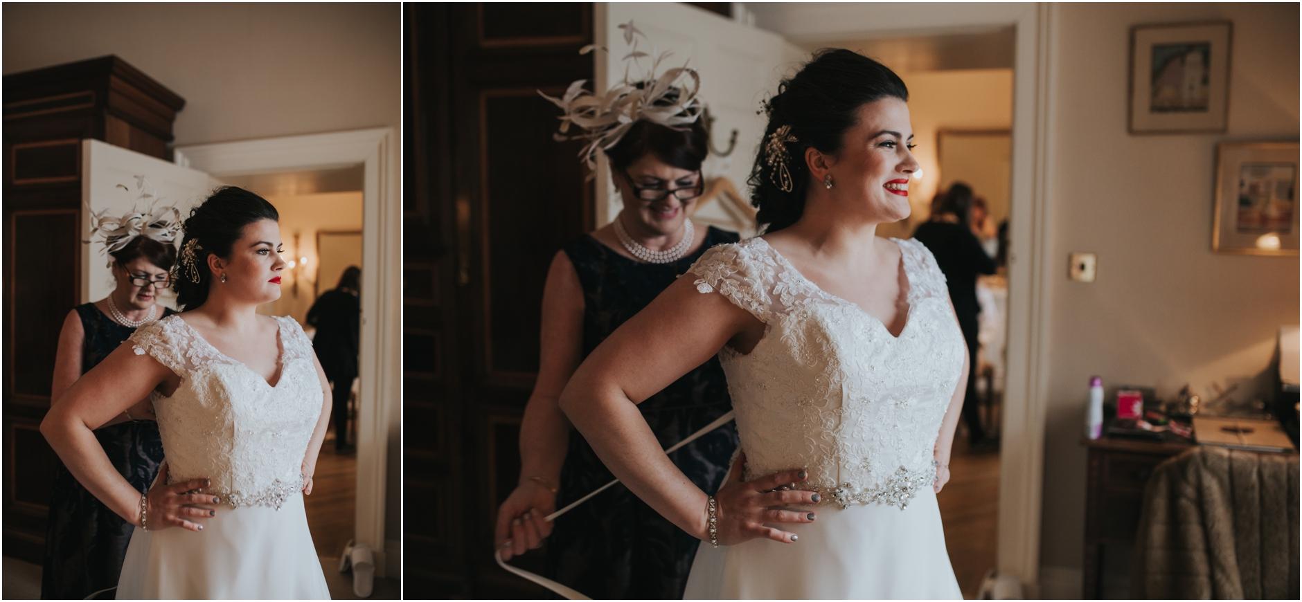 dundas castle wedding brides mum helping her put on her dress