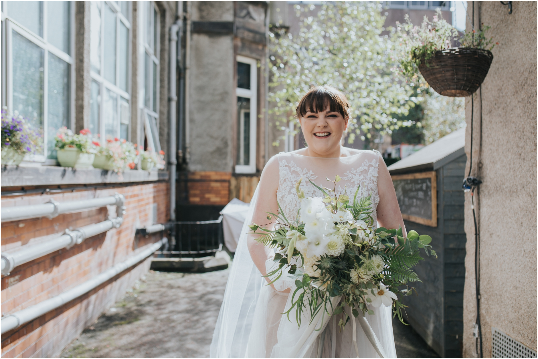 bride smiling and happy on her wedding day at sumerhall edinburgh