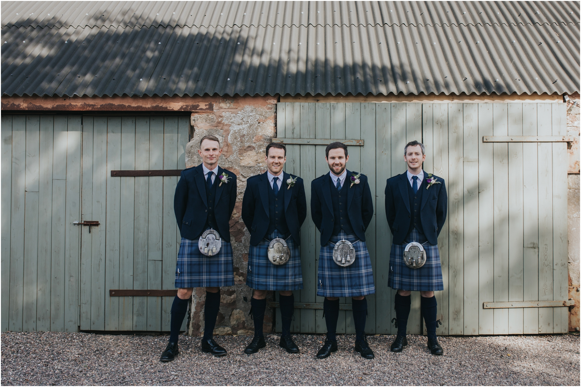 groomsmen portrait at cow shed crail