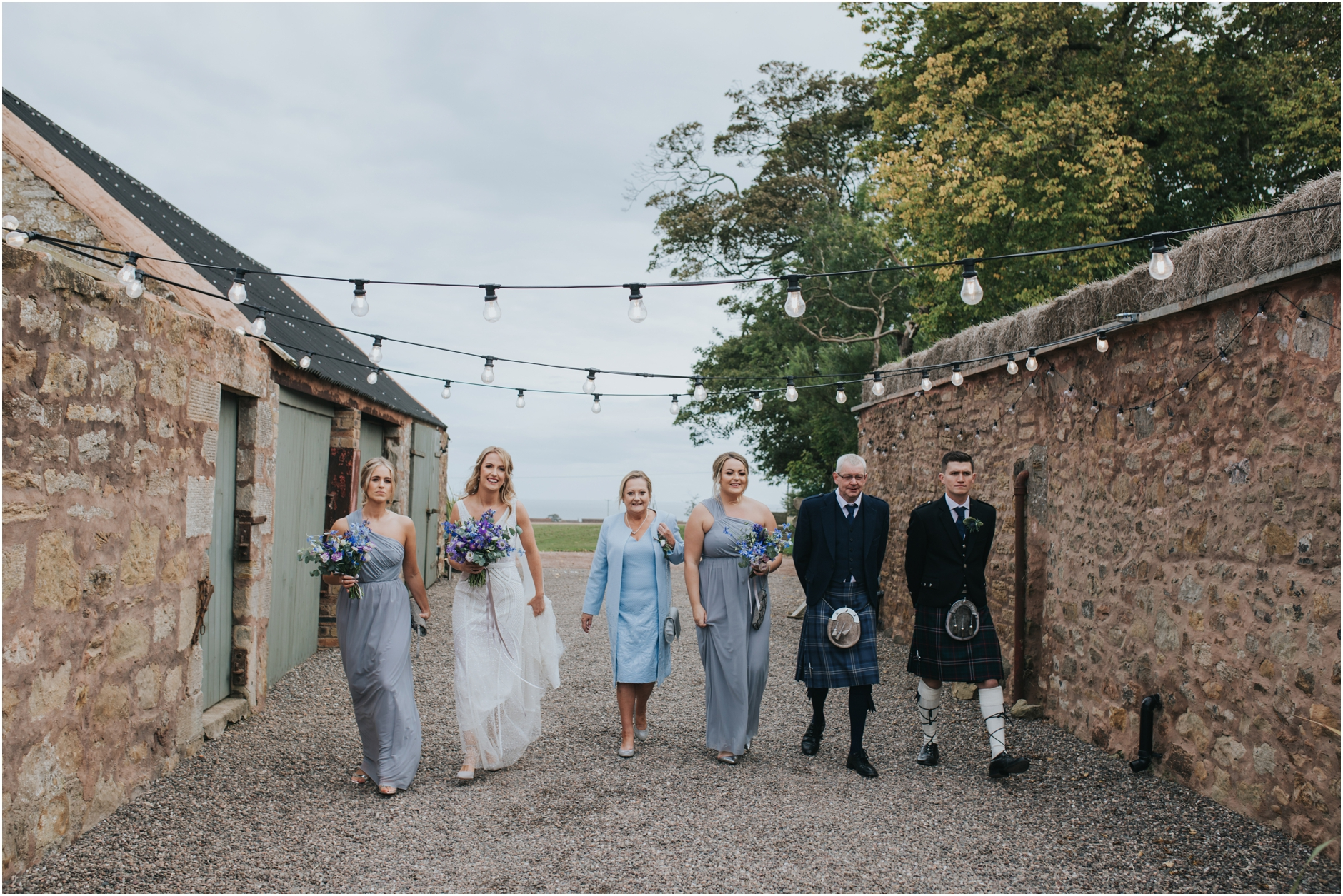 cow shed crail wedding, bride arriving with bridesmaids