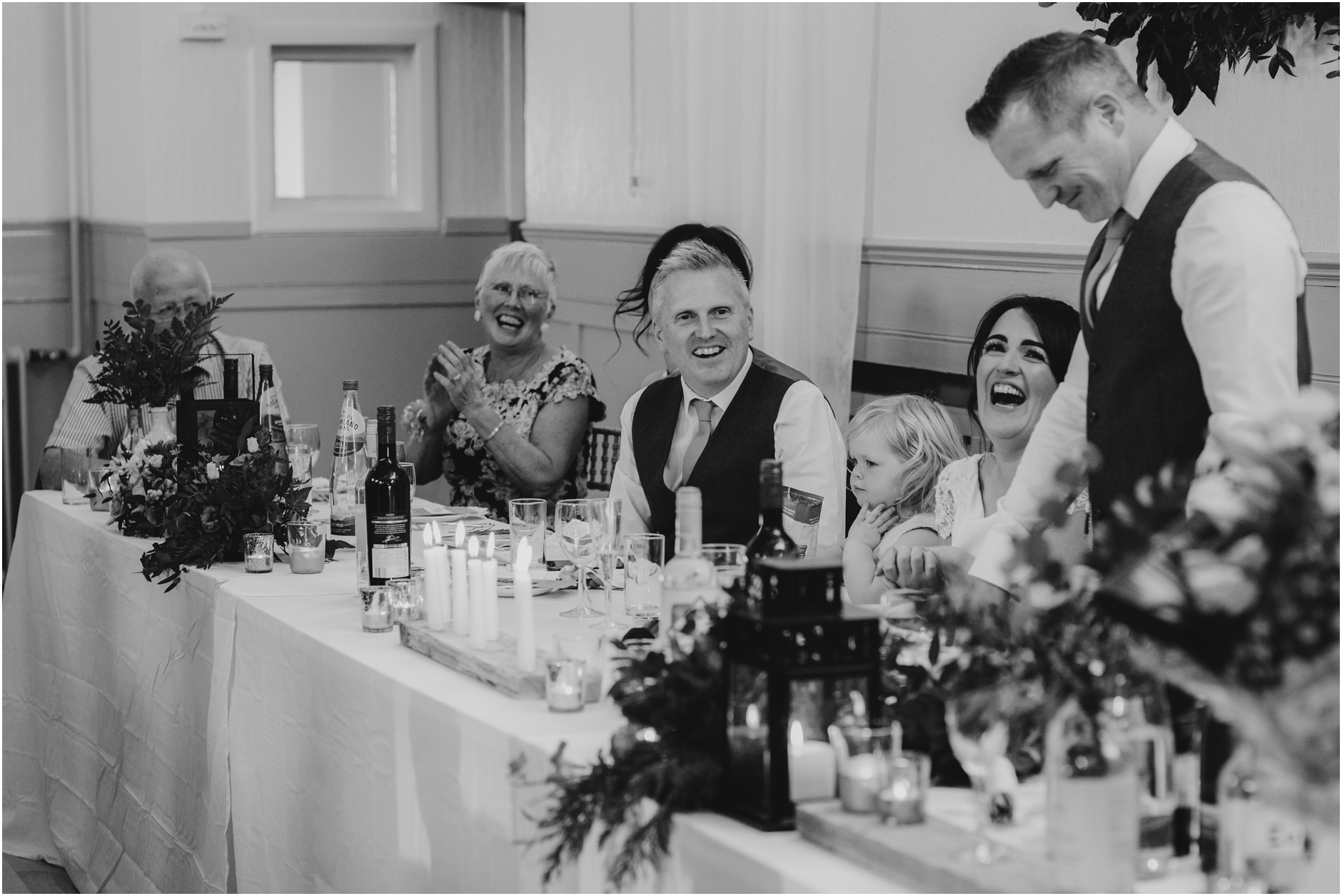 laughing during speeches at monikie village hall wedding