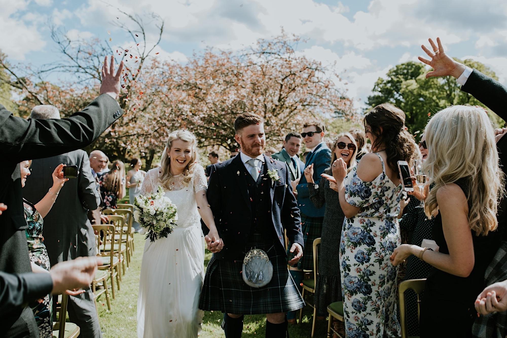 outdoor summer wedding ceremony at kirknewton stables edinburgh rustic barn venue