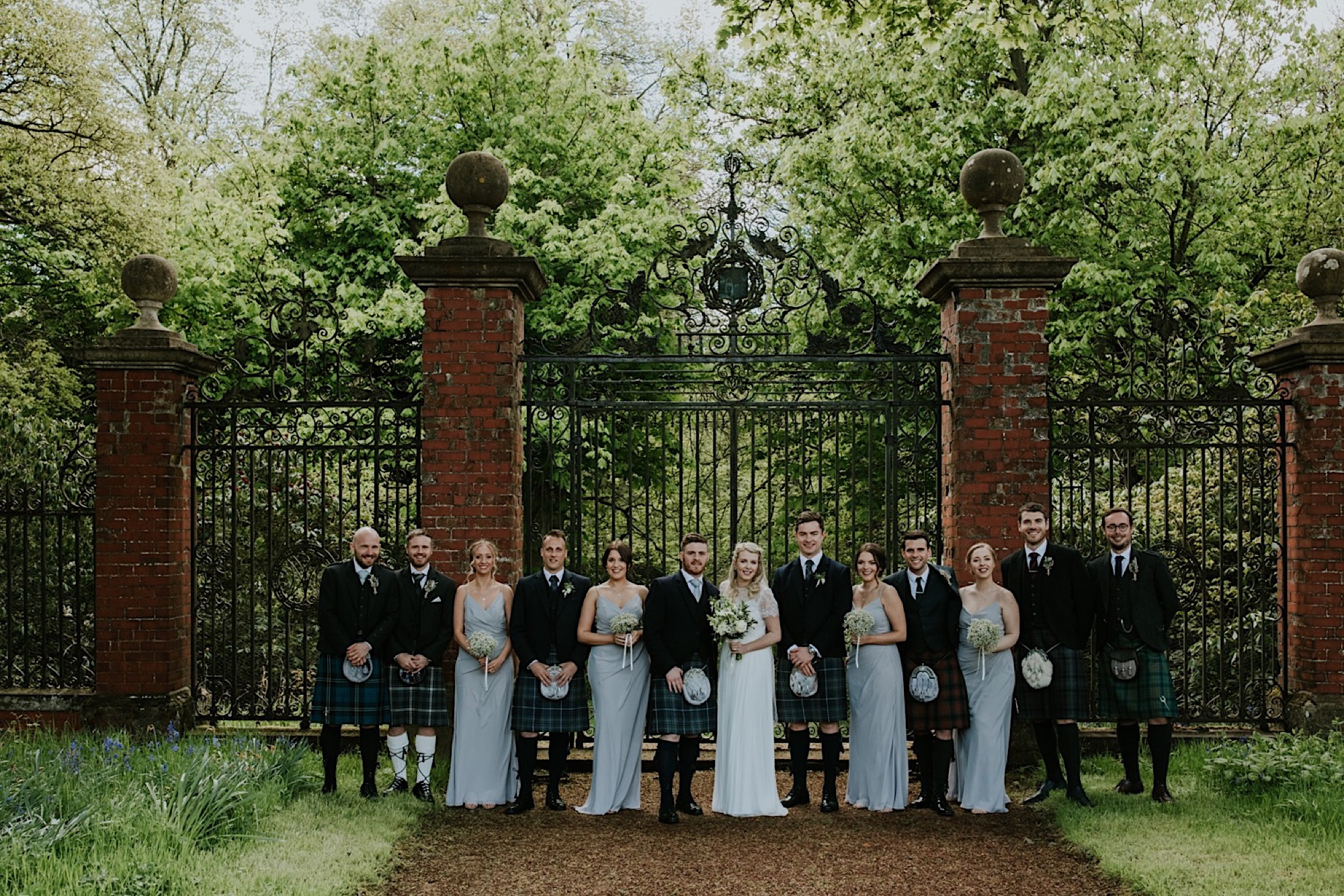 outdoor summer wedding ceremony at kirknewton stables edinburgh rustic barn venue