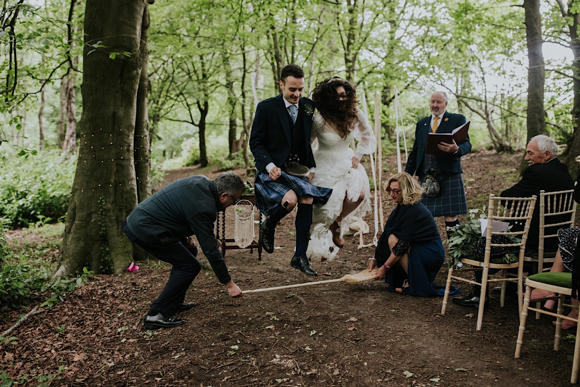 pegan broom jump wedding ceremony, couple jumping over a broom