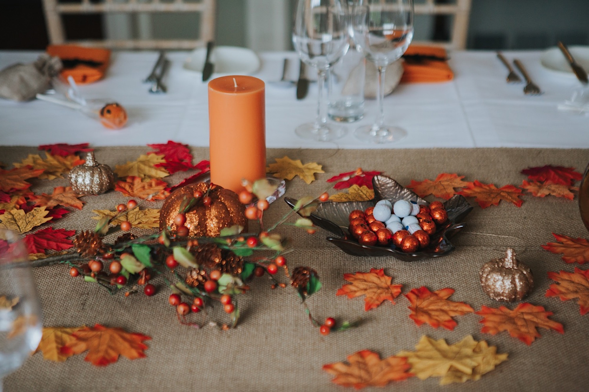 halloween wedding details table set up with pumpkins