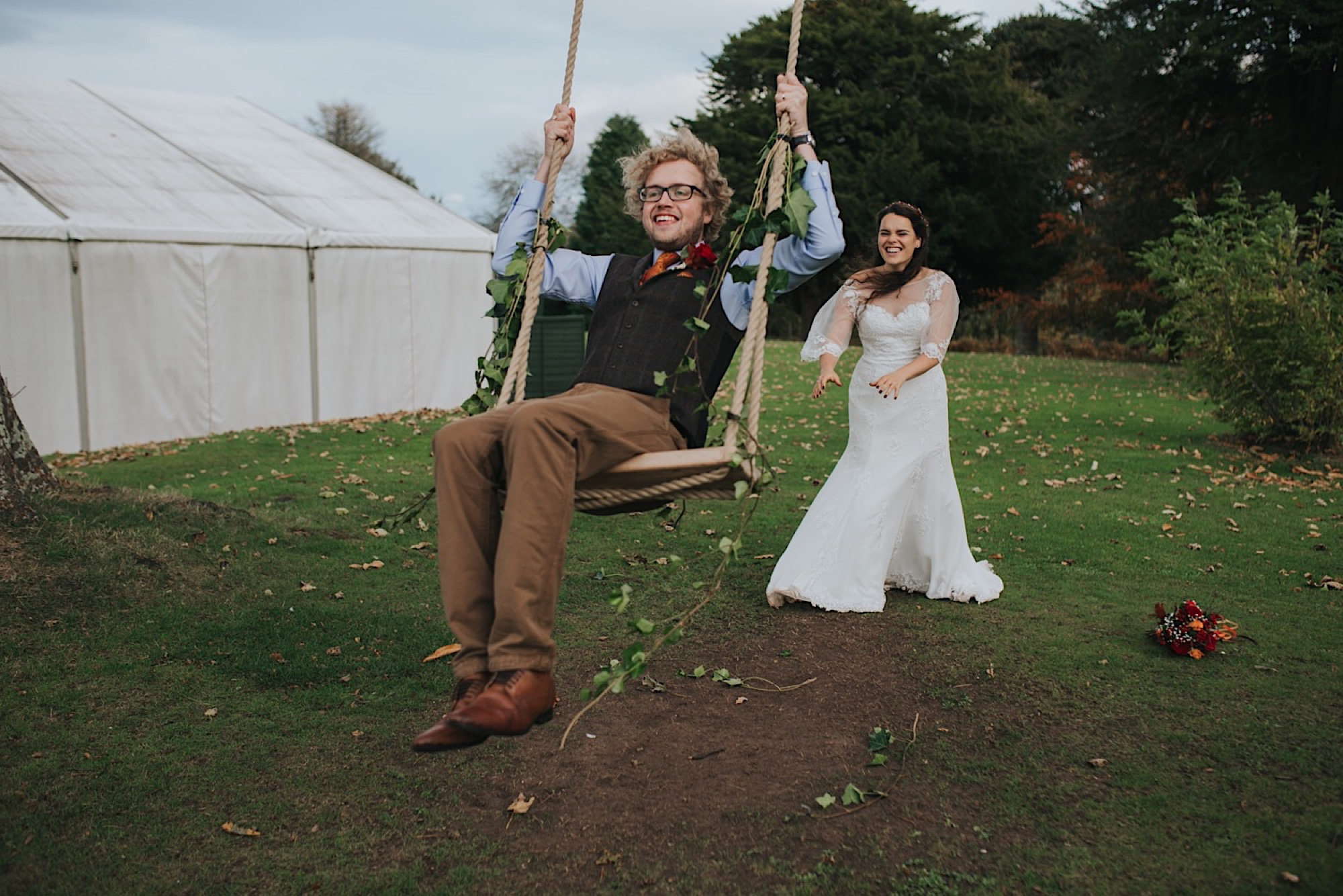 bride and groom on a swing at dunglass estate