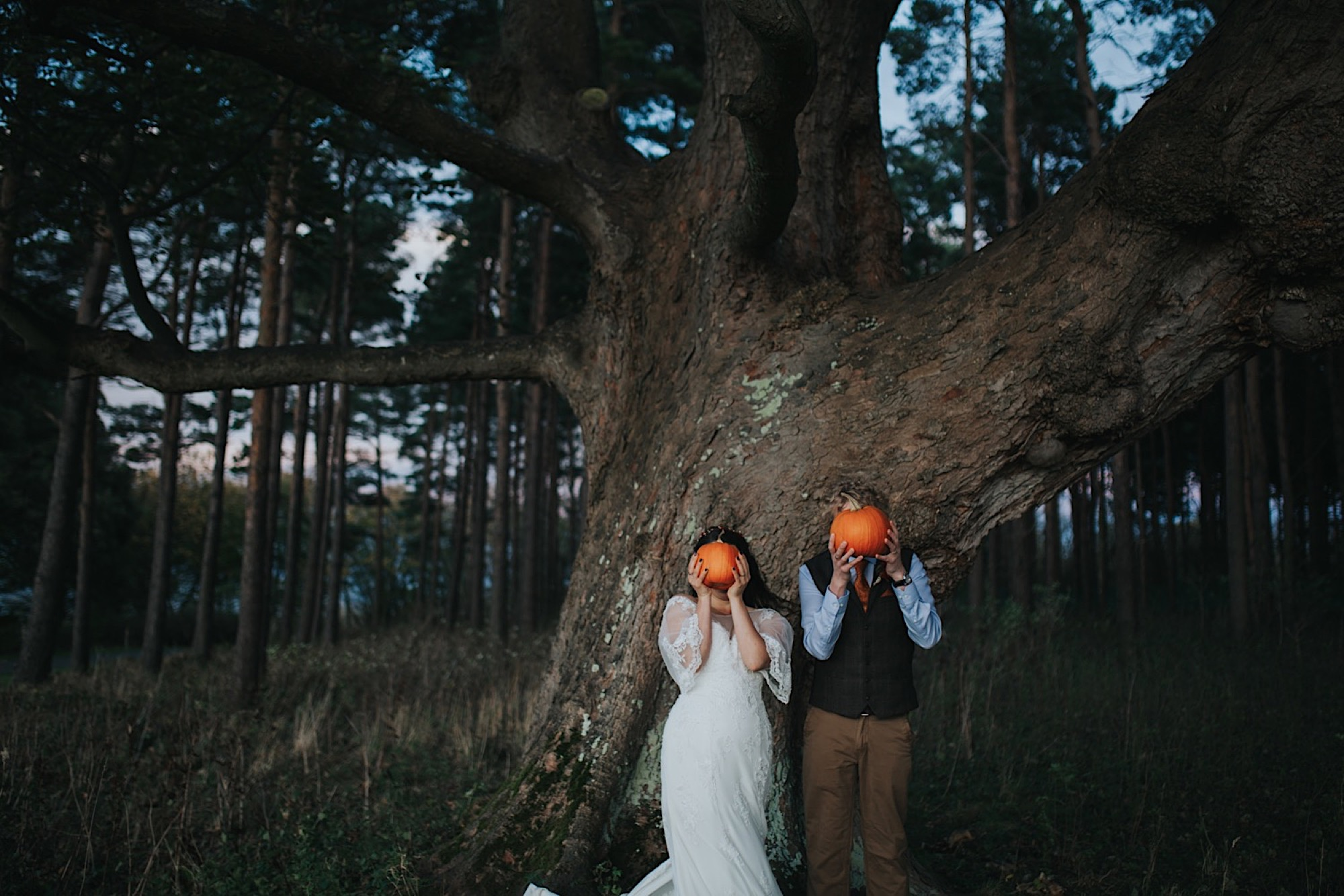 bride and groom portraits with pumpkin