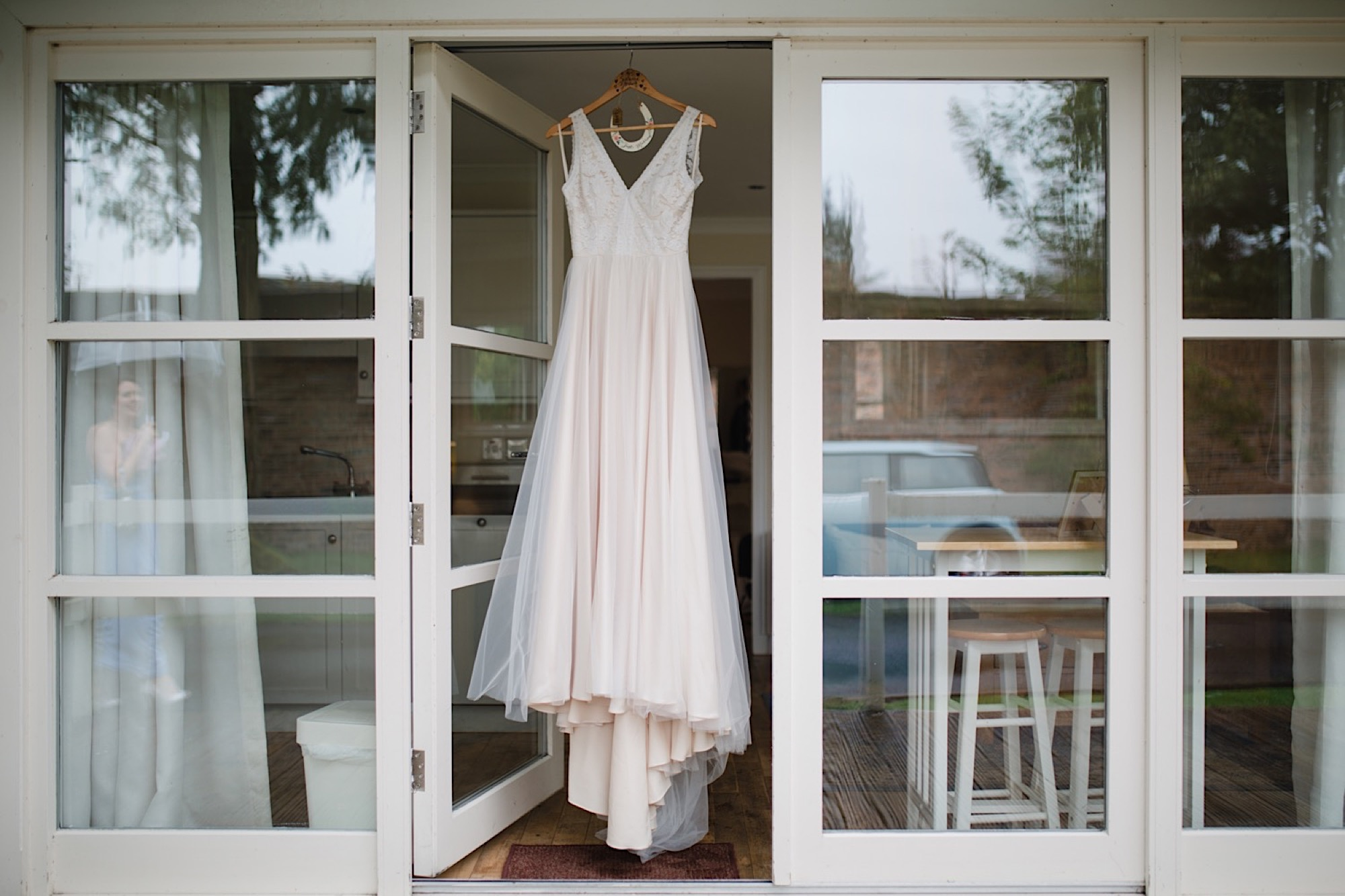 wedding dress hanging outside at the cruin loch lomand