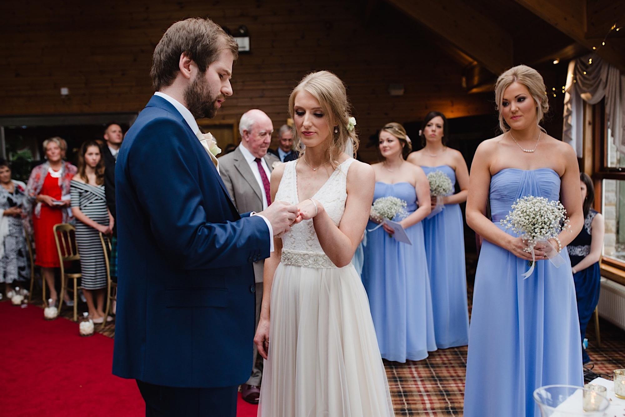 bride and groom exchanging wedding rings