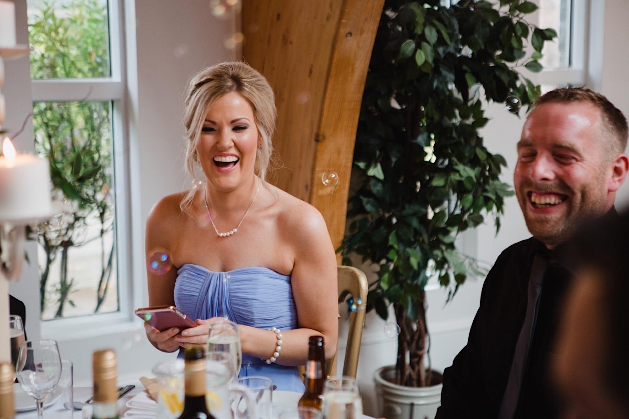 wedding guests happy at loch lomand wedding