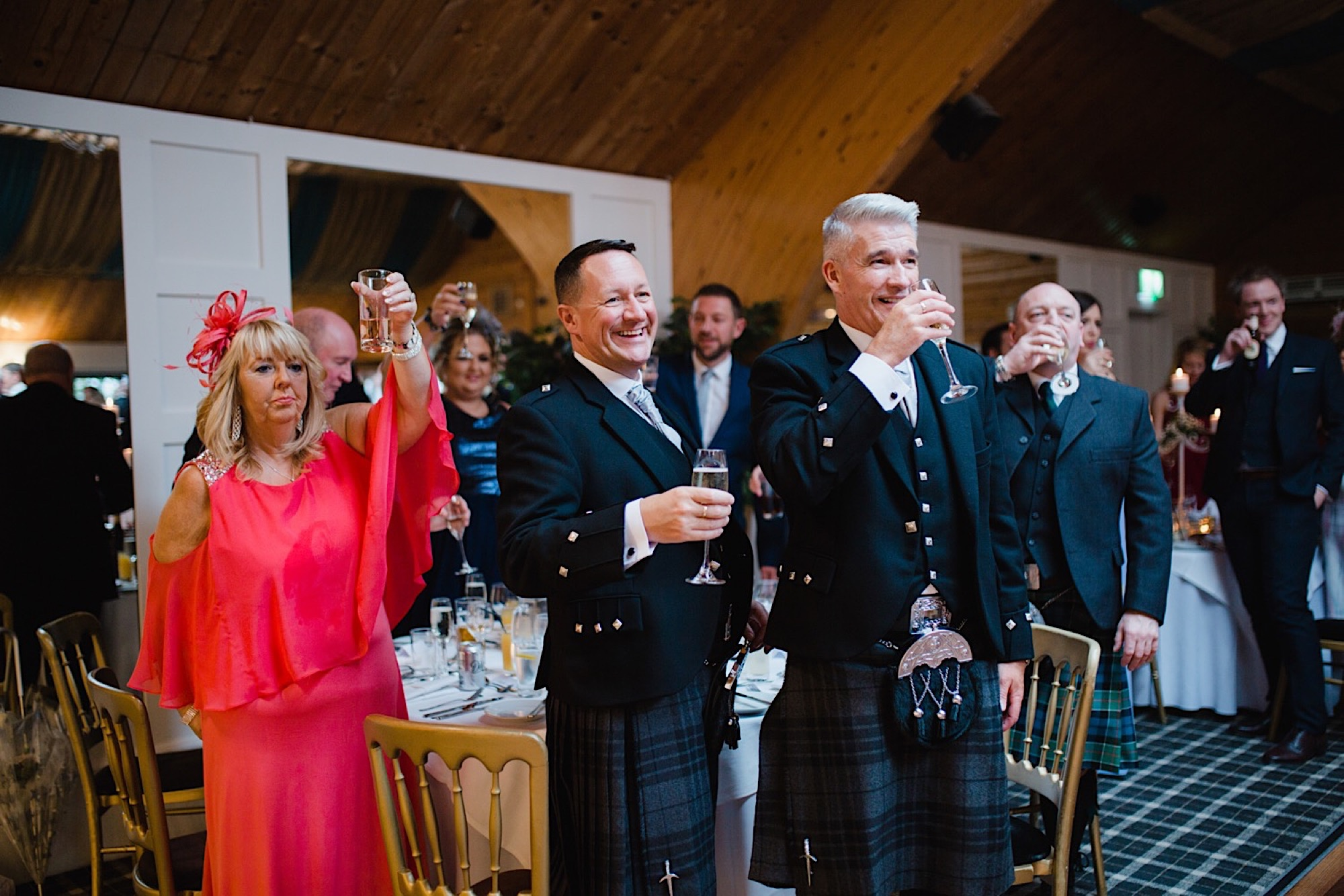 guests toasting the bride and groom