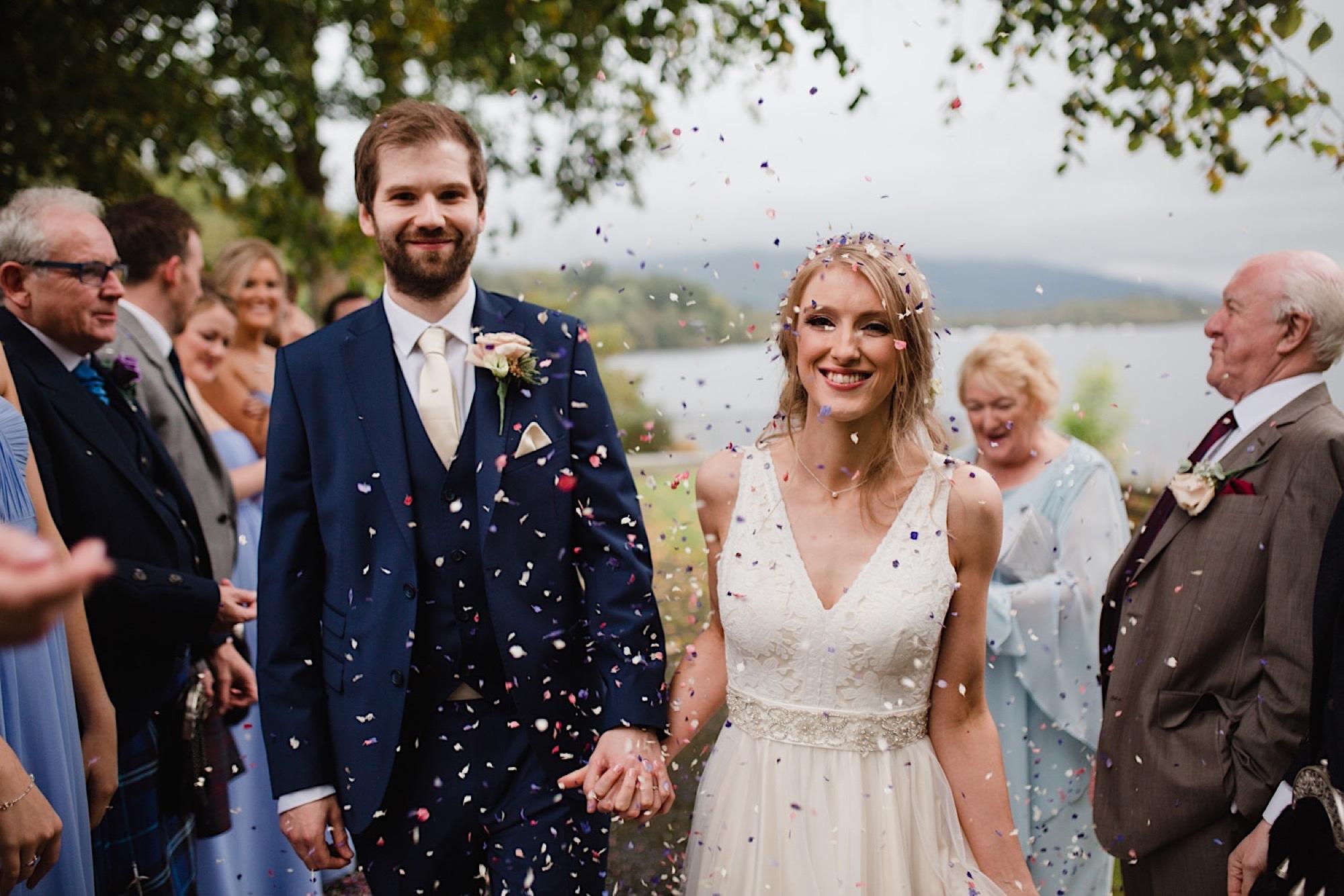 bride and groom having confetti chucked on them loch lomand