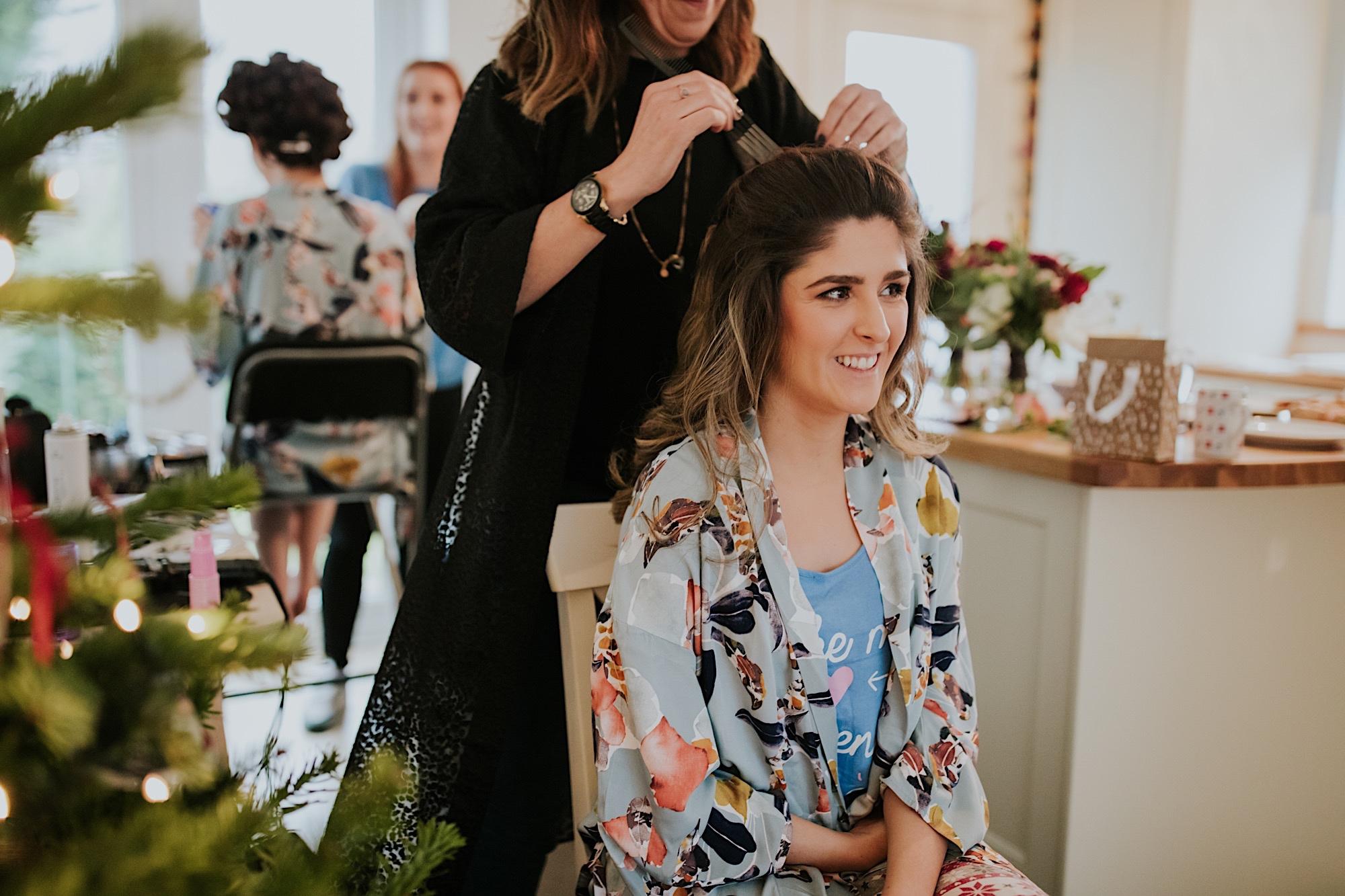 bridesmaid having her hair done