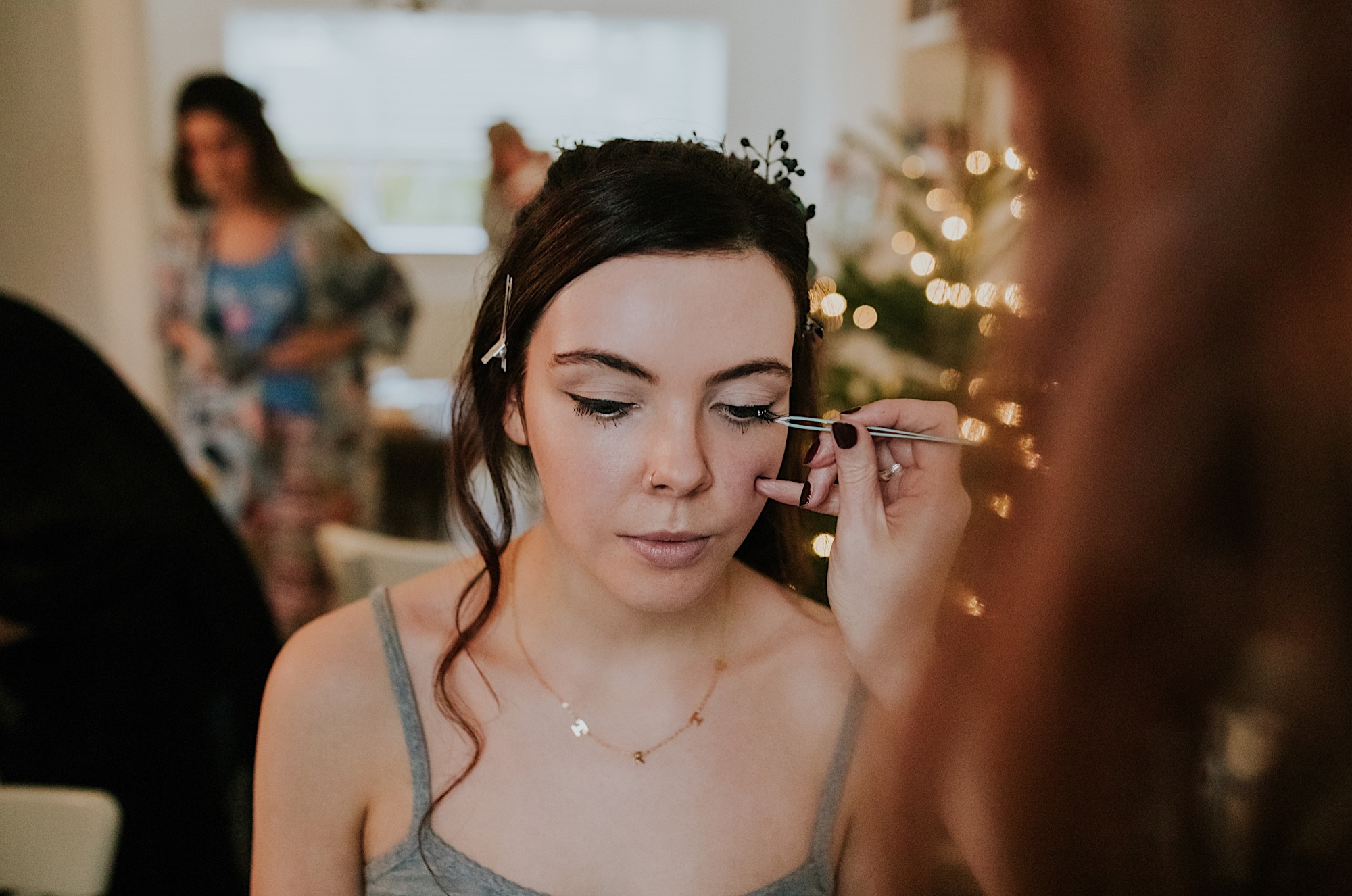 bridesmaid having her make iup done on the wedding morning