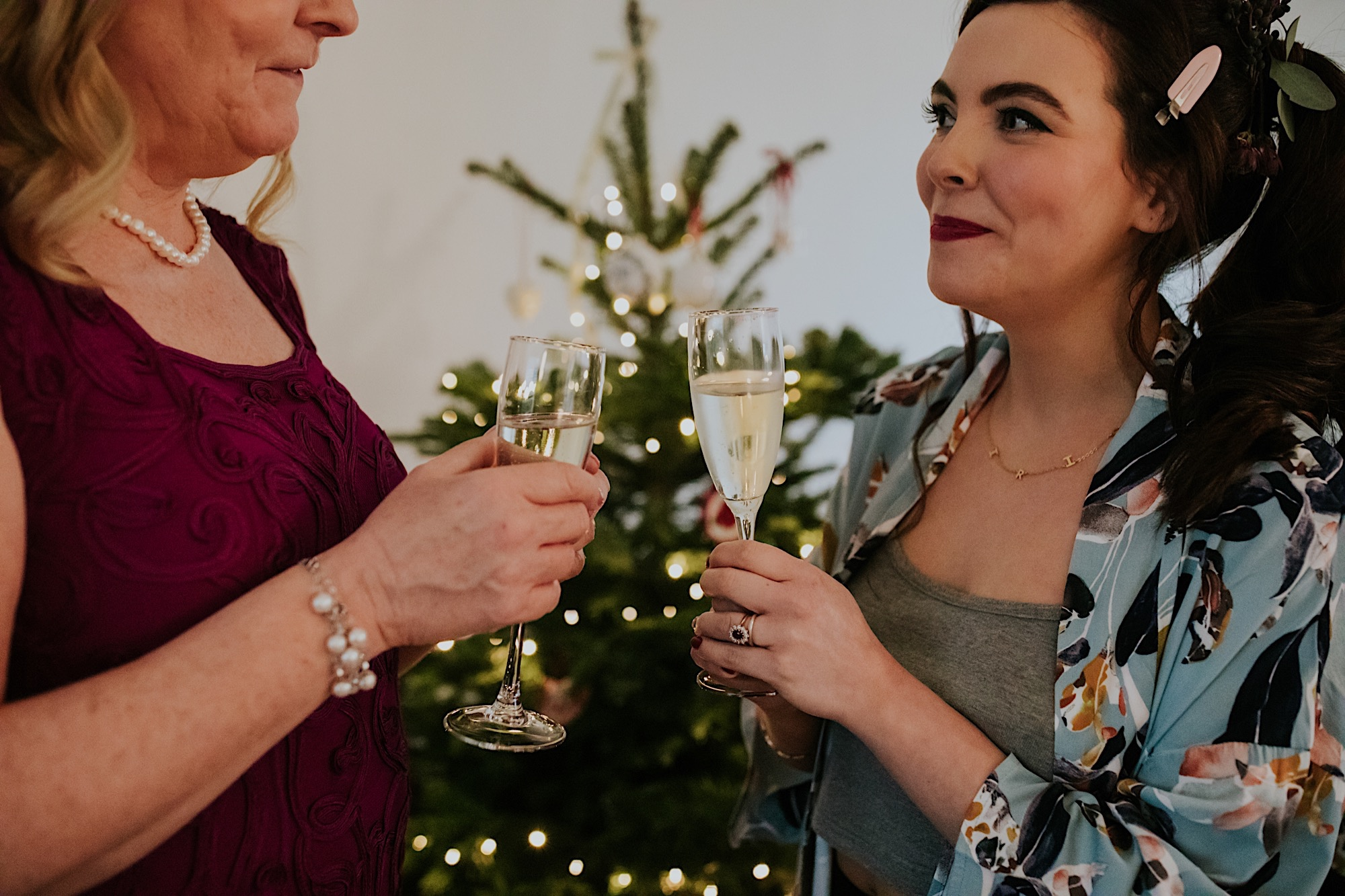 bridesmaid and mother of the bride toasting glasses of fizz
