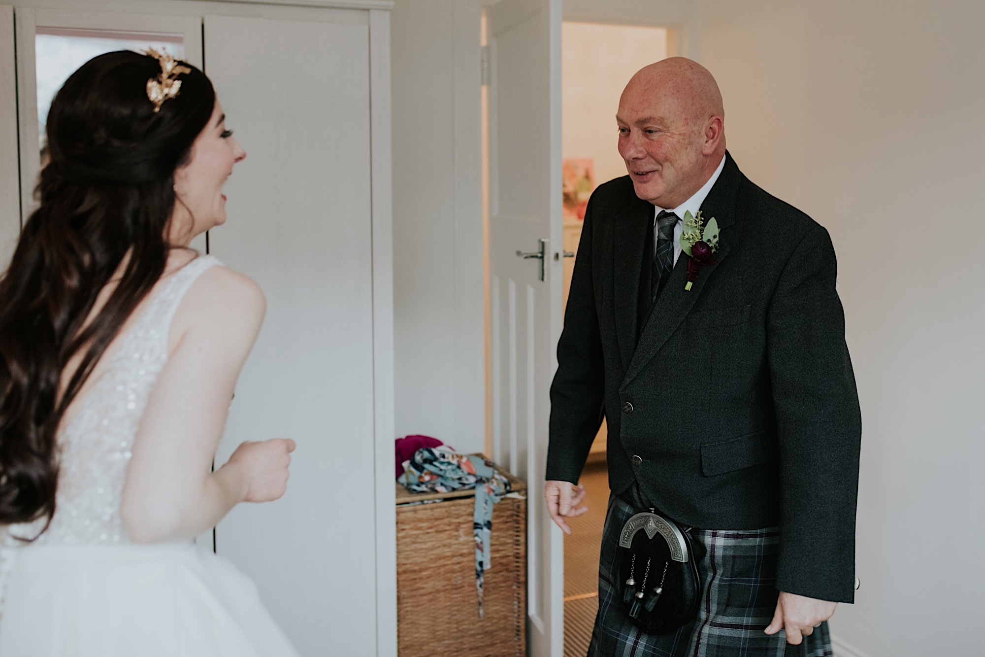 brides dad seeing her in her dress for the first time looking emotional