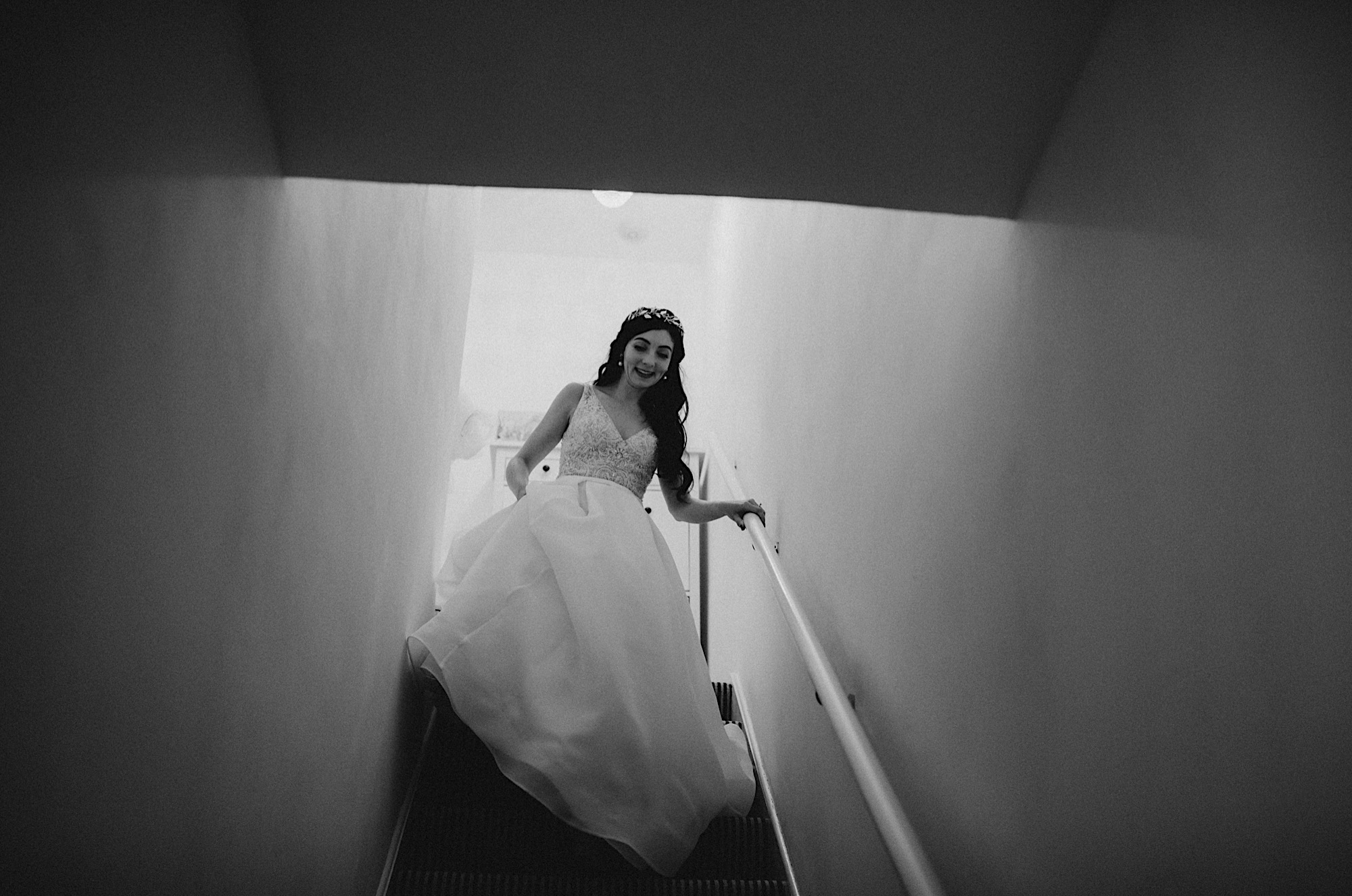 bride walking down the stairs to leave for the wedding ceremony