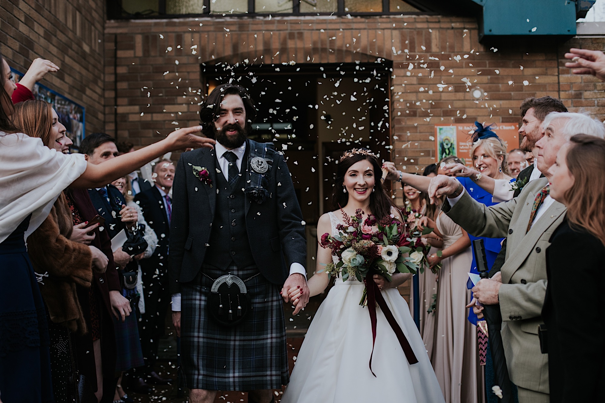 bride and groom haveing confetti thrown at them