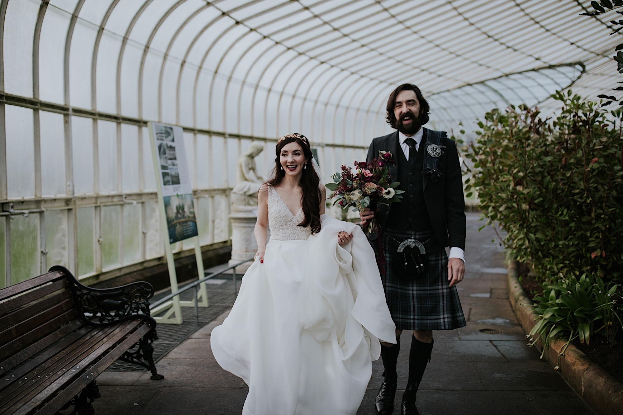 bride and groom walking in the glasshouse glasgow botanical gardens