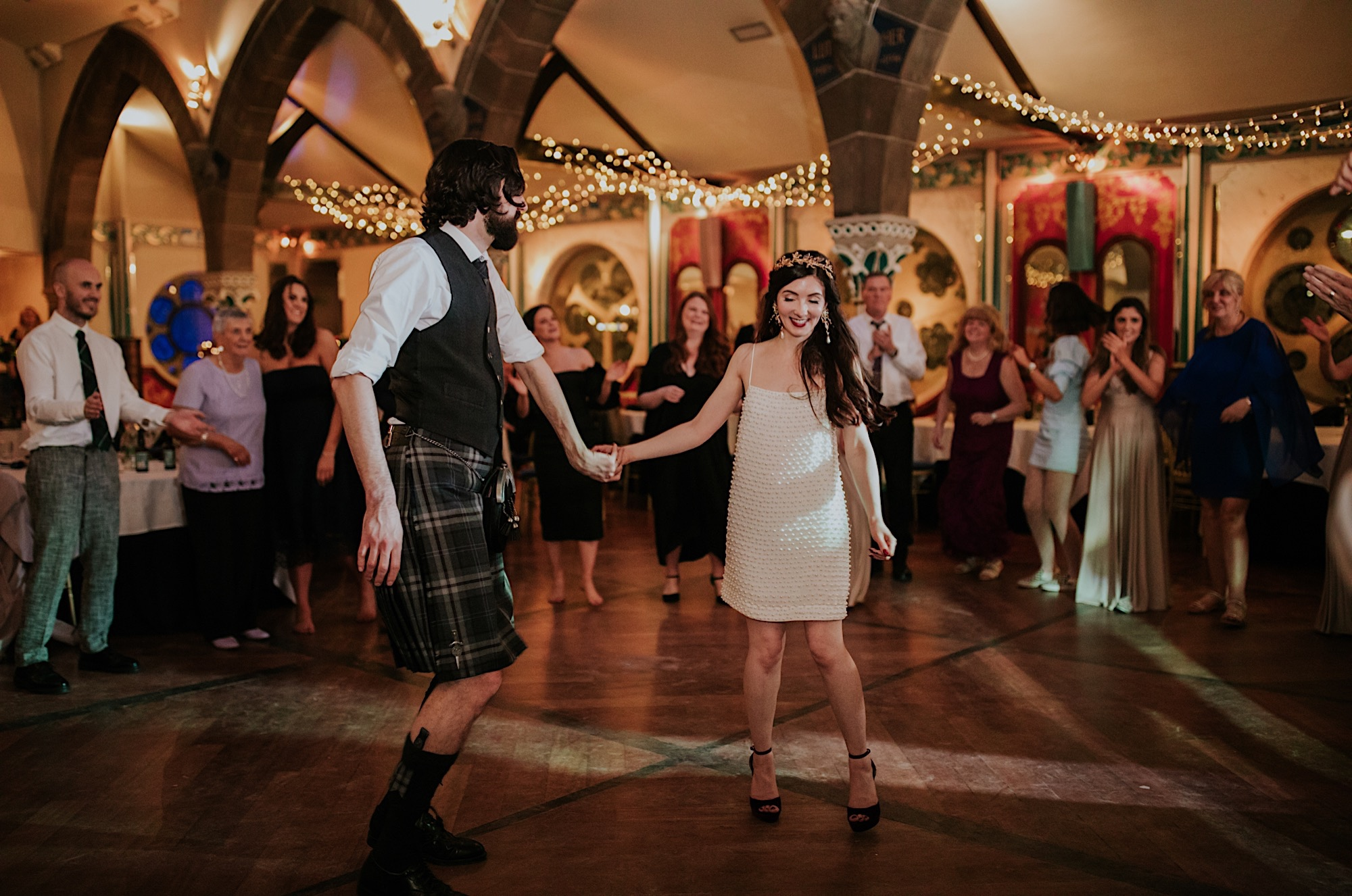 bride and groom dancing surrounded by friends and family at oran more glasgow wedding